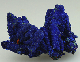 Bright royal blue crystals of Azurite completely cover Calcite crystals. From the Christiana Mine.